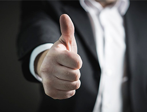male professional approves resume writing tips