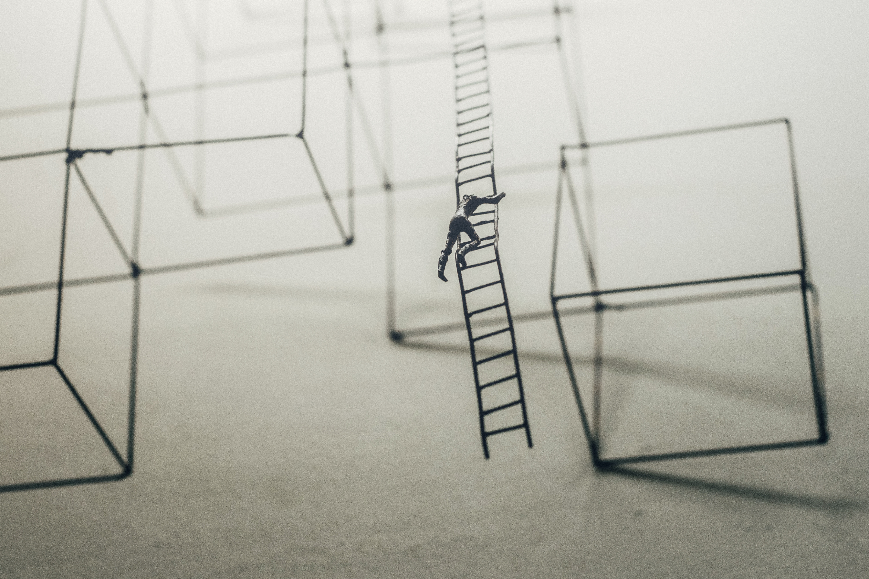 man climbing representing applicants needing executive resumes to climb career ladder