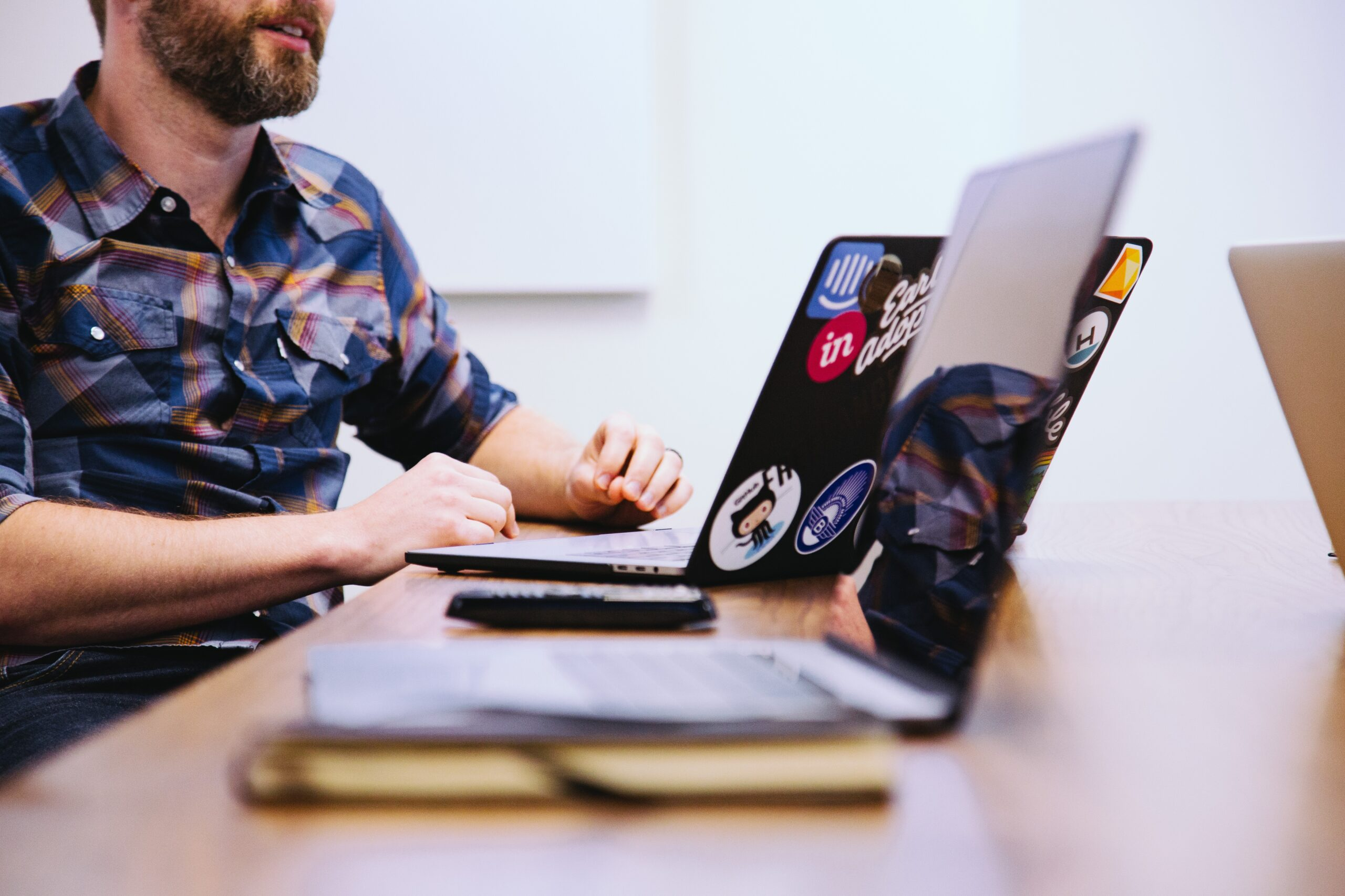 a man using his computer to find ways on how to stop job hopping habits