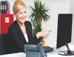 Businesswoman Pointing At Computer