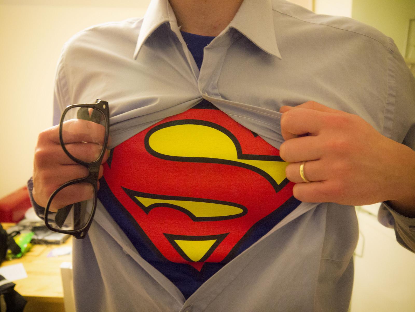 Man revealing his Superman undershirt