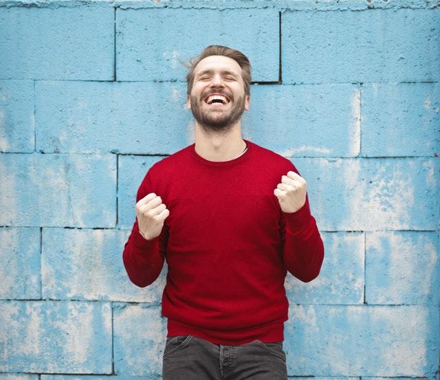 a happy male employee showing work satisfaction
