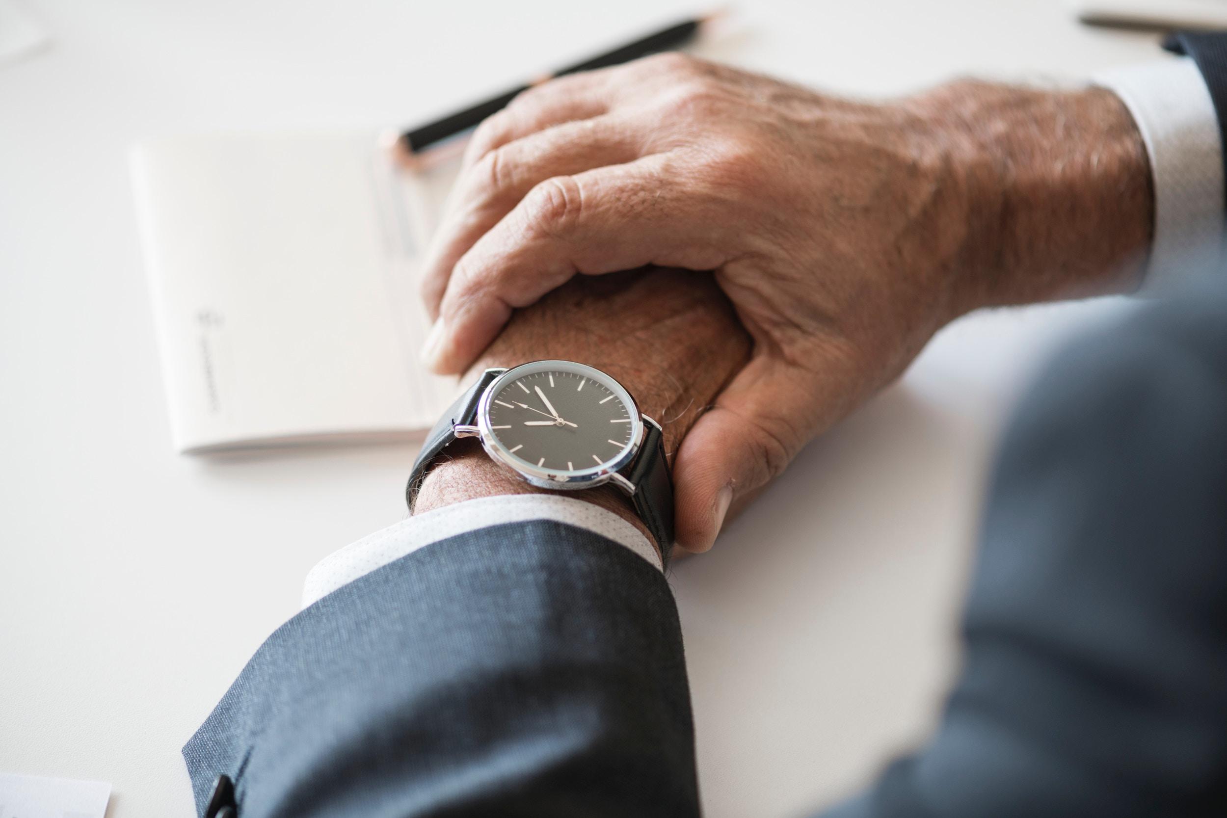 a man wearing a wrist watch during an executive job interview