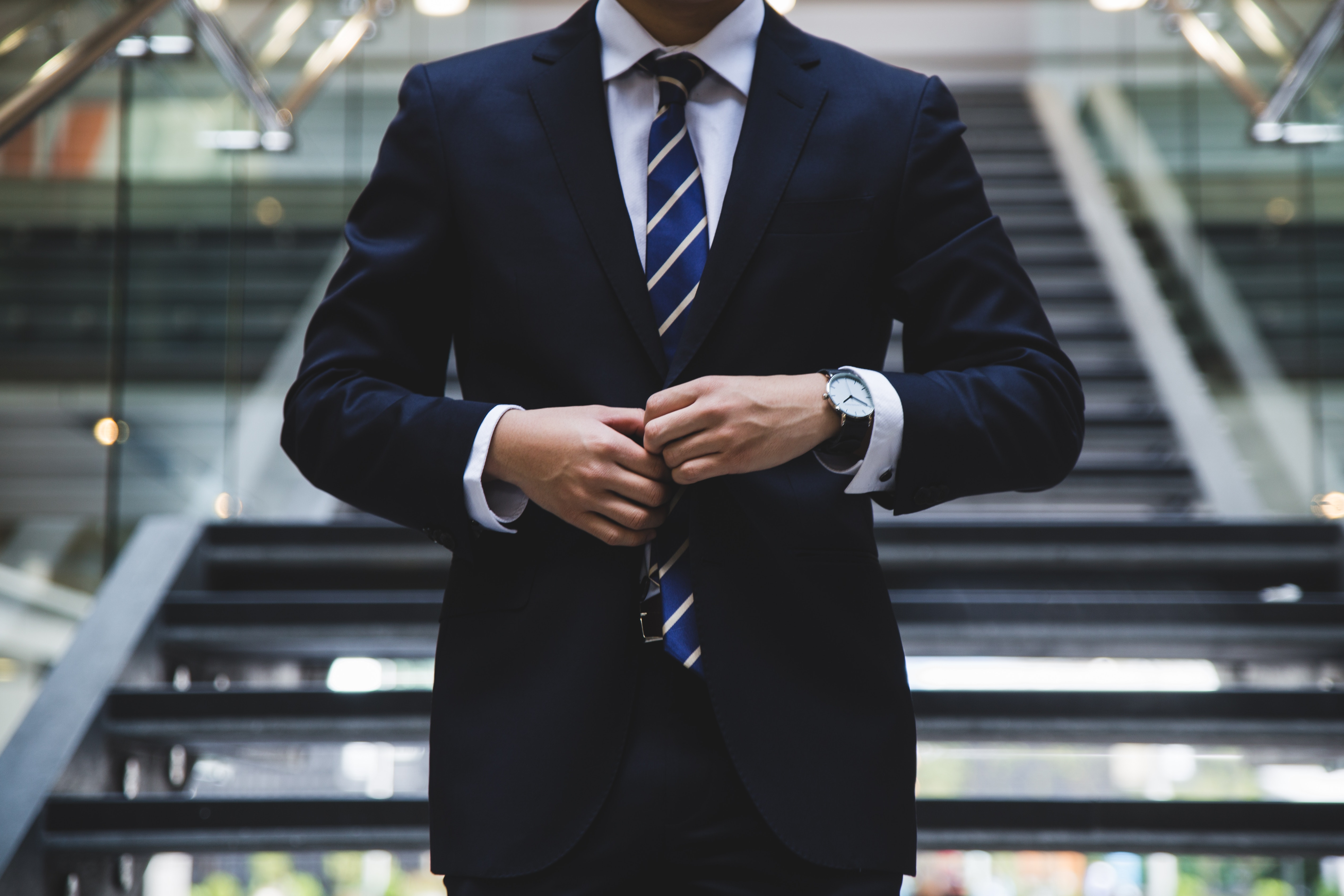 a man wearing nice suits for his executive job interview