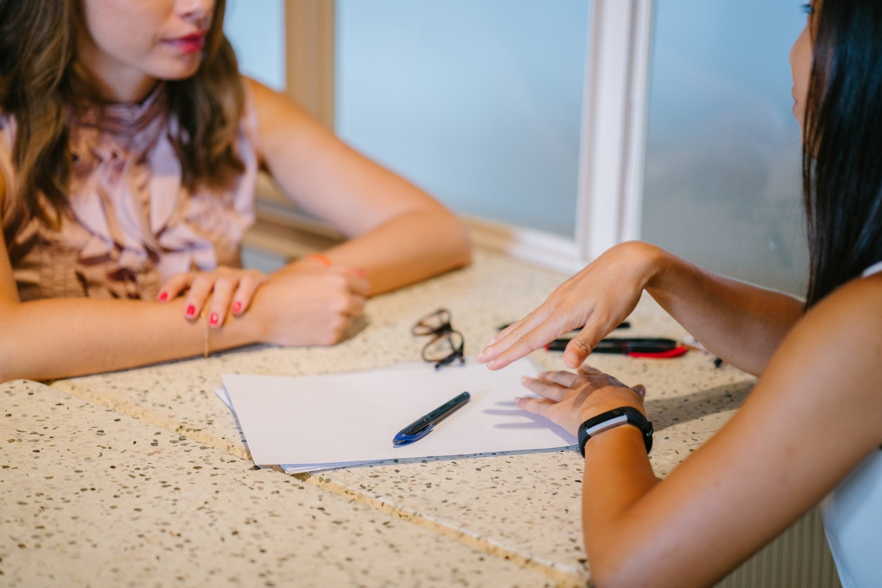 two female in an interview and the other one uses tips from Resume Prime's best resume writers