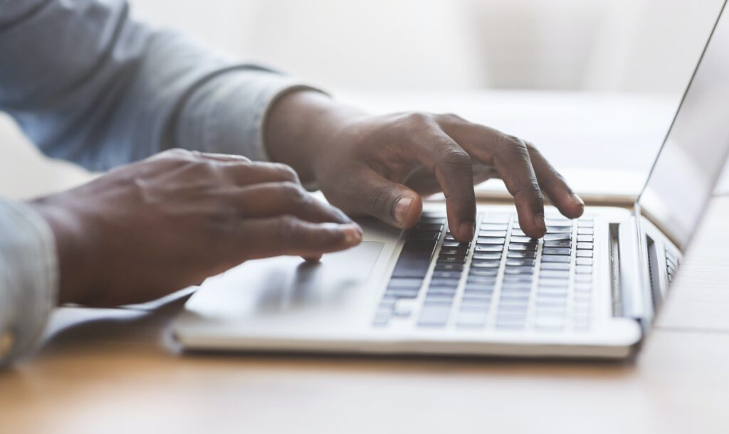 job seeker typing his resume profile