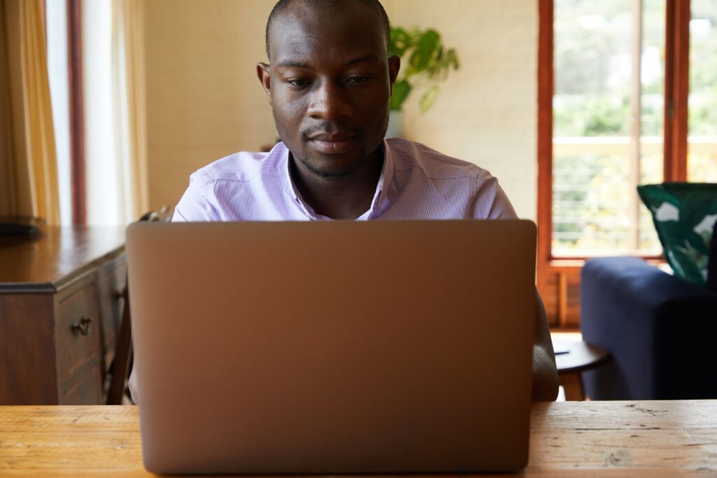 man reviewing his skills for resume on his laptop