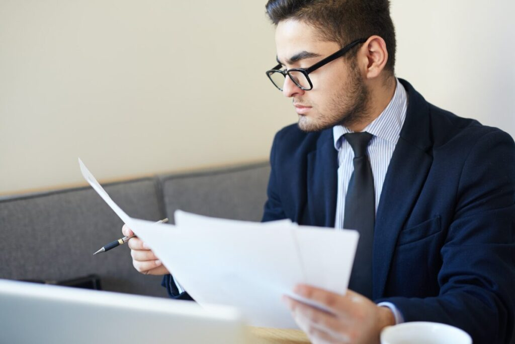 a recruiter reading a resume prepared by an online resume writing firm