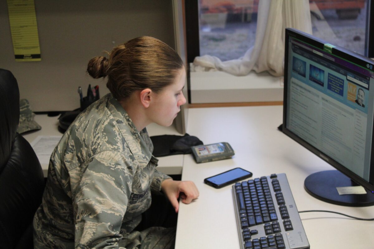 young woman in the office reviewing a military resume