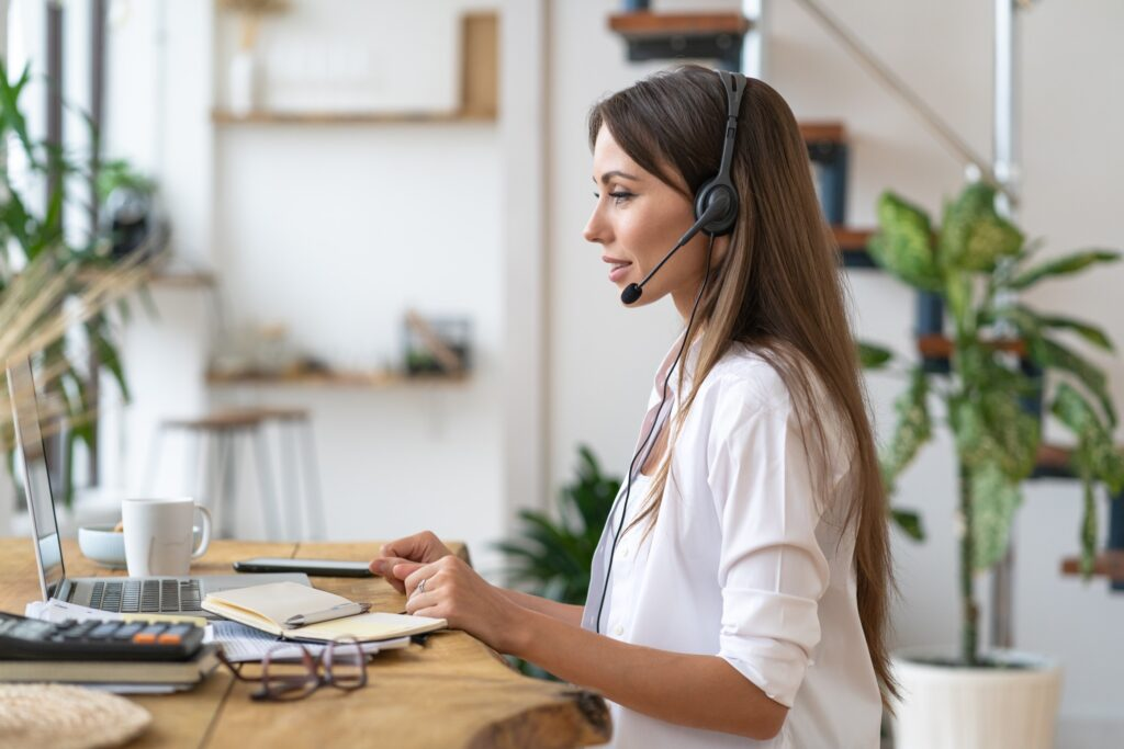 focused businesswoman participates in video interview