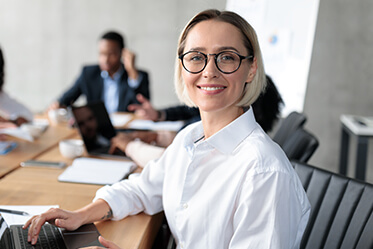 Corporate Woman Smiling Confidently