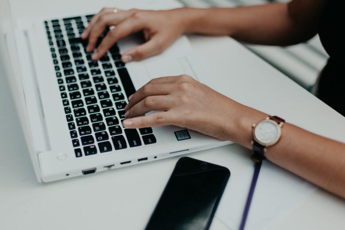job seeker typing his resume on his laptop